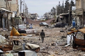 Executed ISIS fighters lined up in the ruins of border town of Kobane