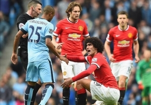 Fellaini hits back after spitting accusations