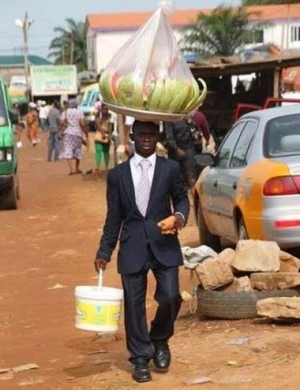 Ghanaian Man Dresses In A Suit To Sell Water Melon On The Streets