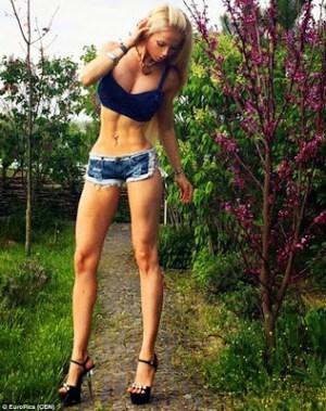 Human Barbie Valeria Lukyanova Shows Off Tight Abs