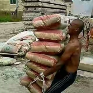 Is This Possible? See Photo Of A Man Lifting 7 Bags Of Cement