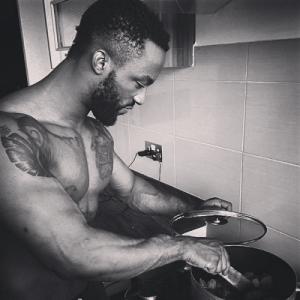 Iyanya and his sexy abs cook in the kitchen..
