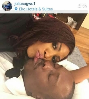 Julius Agwu shares loved up photo with his wife in their hotel room