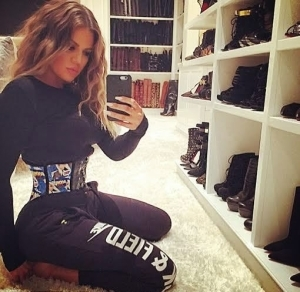 Khloe K shows off waist trainer & boots section of her closet