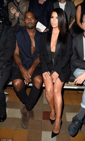 Kim Kardasian and Kanye West Both Show Off Their Cleavages