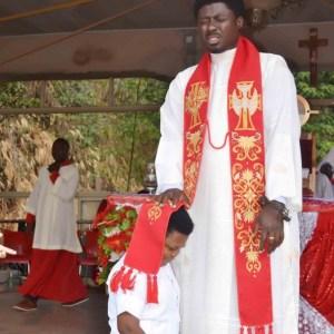 Osita Iheme Receives Special Prayers From Catholic Priest (photo)
