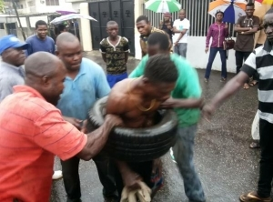Photo: Car Thief Burnt By Angry Mob In Lagos
