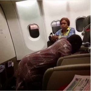 Photos: Nigerian Man Spotted Praying On His Knees In An Airplane
