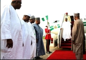 Photos: President Muhammadu Buhari Returns To Abuja From His Trips To Niger, Chad