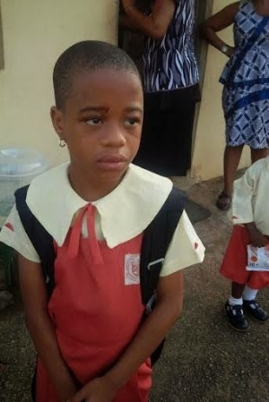 Photos: Young girl allegedly battered by her father