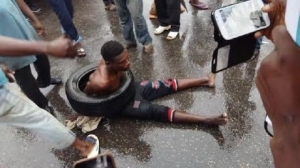 Photos Of Mob On Allen Avenue Lagos About To Burn A Car Thief Caught In The Act