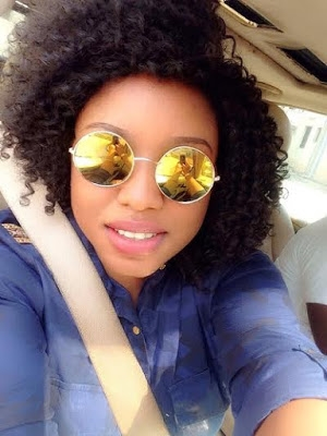 See Lady That Lady Says She Looks Like Rita Dominic