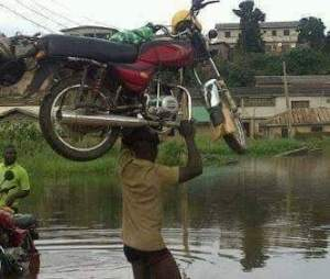 Wahala Dey OO!! See How This Man Carried His Motorcycle Due To Lagos Flood