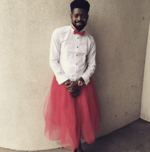 Yay Or Nay? Comedian Basketmouth Goes Feminine With Skirt & Bold Tie In New Photo – PEEK