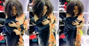 Busted: Bobrisky grabs his fake breasts as they almost fell off the bra in new video