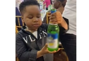 Little Boy Consumes Full Bottle Of Beer In The Presence Of His Parents At A Party (Watch Video)