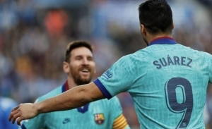 Luis Suarez gives his opinion on where former Barcelona team-mate Lionel Messi should play next season