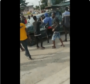 Angry mob reject Nigerian army officer's money after stopping them from passing in Gbagada (Video)