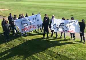 Manchester United fans block training ground entrances in protest against owners