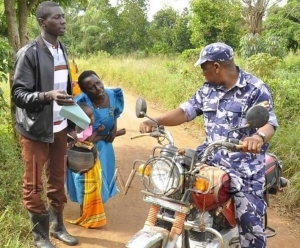 COVID-19 Lockdown: Woman kneels down begging police officers not to confiscate motorcycle of a rider carrying her and sick child to hospital (photos)