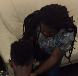 Video: Patoranking Receives Spiritual incarnation from Dadday Shokey (Water Over Head)