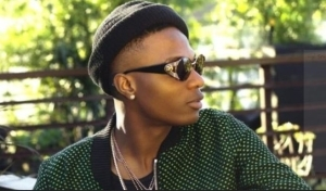 Too Much Money! Wizkid Gets A Customized Private Jet Floormat (Video)