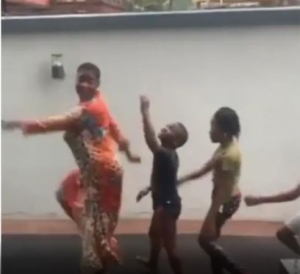 Actress Mercy Johnson Spotted Playing In The Rain With Her Children (Video)