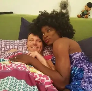 Gay rights activist, Bisi Alimi shares loved-up photo of himself in bed with his husband