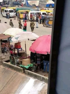 Soldiers Brutalize and Drag Actor Chinwetalu Agu on the Road For Wearing 'Biafra Outfit' (Video)