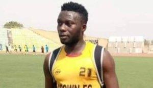 Nigerian Footballer Slumps During Football Match