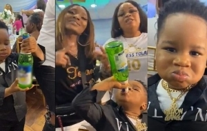 """""""This Is Failed Parenting"""" – Nigerians React To Video Of A Little Boy Taking Alcohol From A Beer Bottle"""