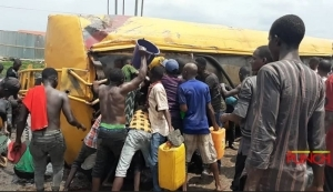 Drama As Youths Storm Tanker Accident Scene To Scoop Fuel In Lagos Despite Lockdown (Photo)