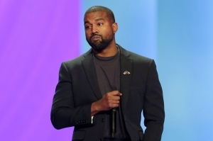 Kanye West celebrates as he claims he now has a net worth of $5billion after falling '$53 million in debt'