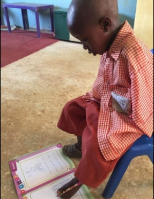 Meet 4-year old armless Nigerian schoolboy who writes with his toes