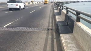 GOOD MOVE!! Police In Lagos Prevent Frustrated Man From Jumping Into The Lagoon (Photos)