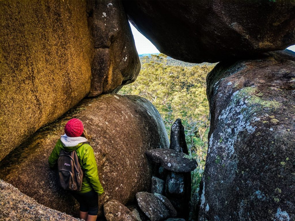 A Maze Of Balancing Boulders // Cathedral Rock National Park (NSW) Luke Mallinson, opening, hiker, red beanie, framed view, trees,