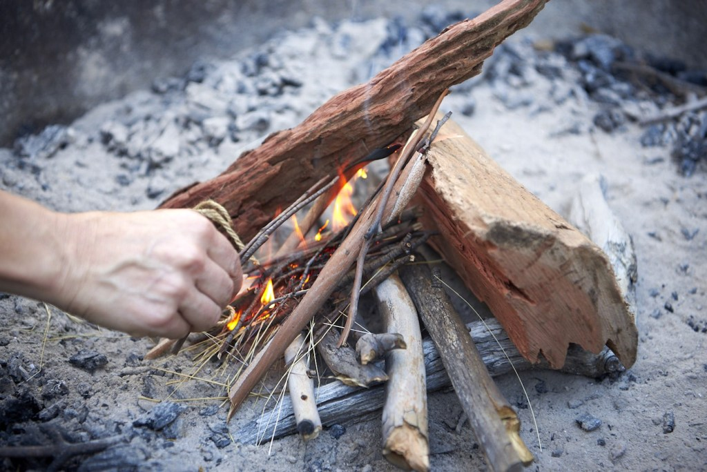 How To Make An Awesome Campfire Without Matches, Neil and Gabbi Massey, kindling , on fire, starting, wood, sticks, lighting