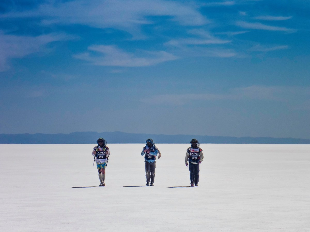 Adventure Racing 101 // How, What, Why...And Why Again? Emily Rowbotham, photo by David Barlow Navigating Lake Frome in the Flinders Ranges, desert, sand, team, hikers, horizon