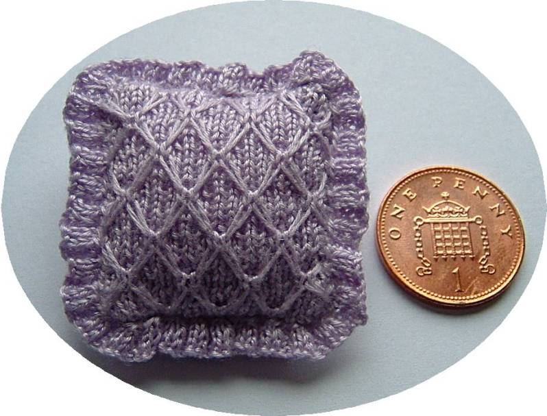 miniature knitted cushion