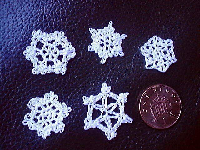 miniature crochet snowflakes