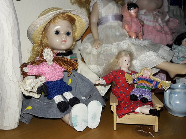 miniature knitted dolls with larger dolls