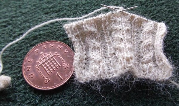 miniature Aran knitting on needles