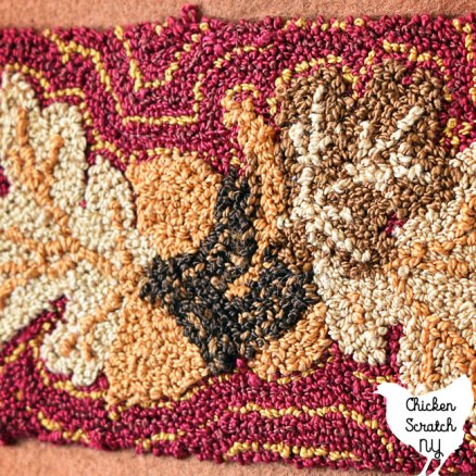 punch needle embroidery close up for acorns and oak leaves