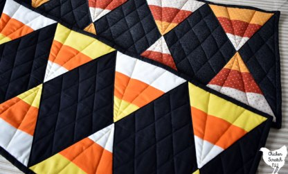 two candy corn table runners
