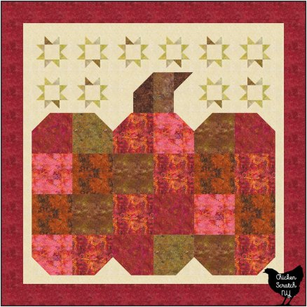 the great pumpkin throw quilt made with red, orange and brown batiks