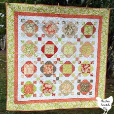 cake show quilt made with a strawberries and rhubarb layer cake from fig tree co