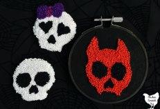trio of punch needle cartoon skulls
