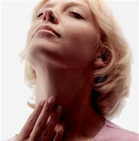 post partum thryoiditis woman looking up touching neck