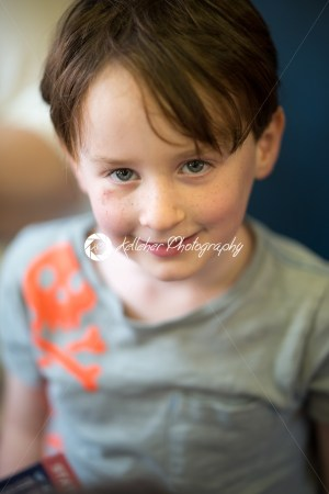 Close Portrait of Boy Smiling Sitting Down - Kelleher Photography Store