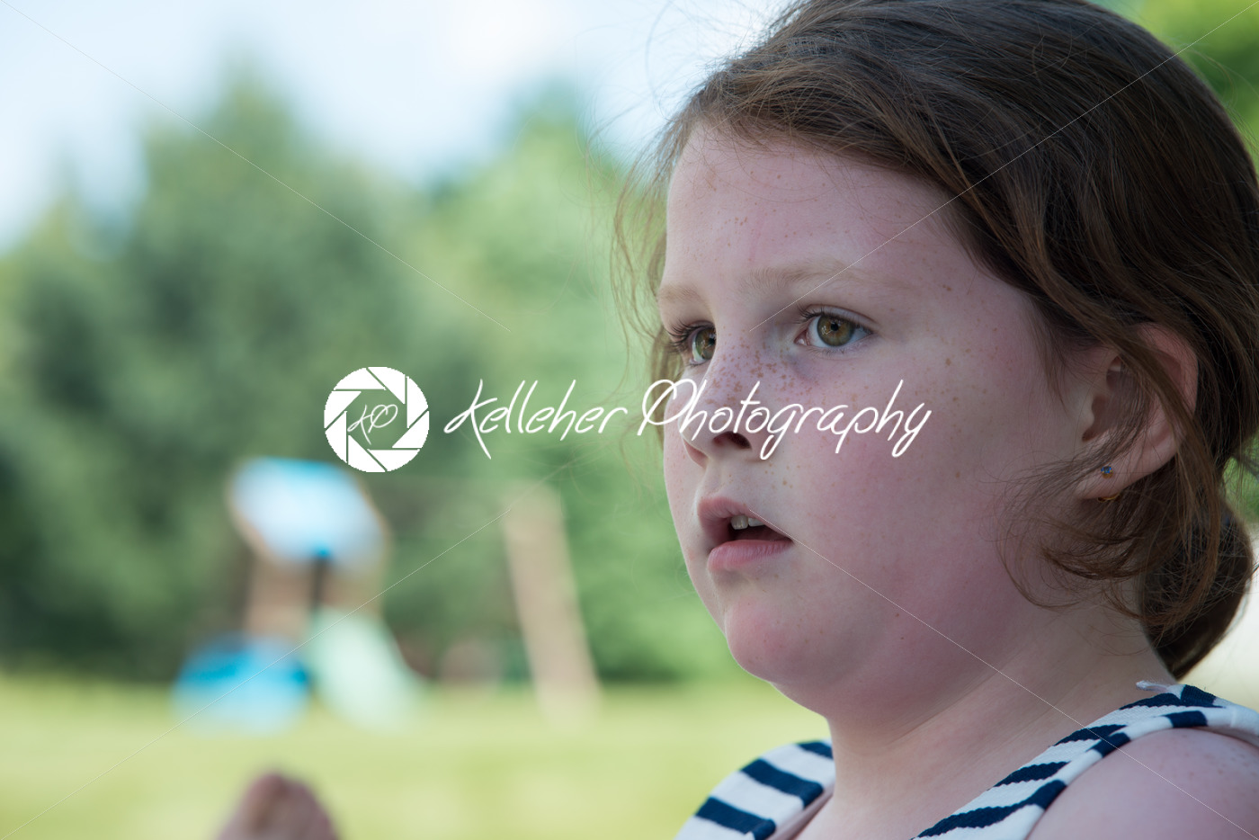 Close Portrait of Young Girl Looking Concerned Outside - Kelleher Photography Store